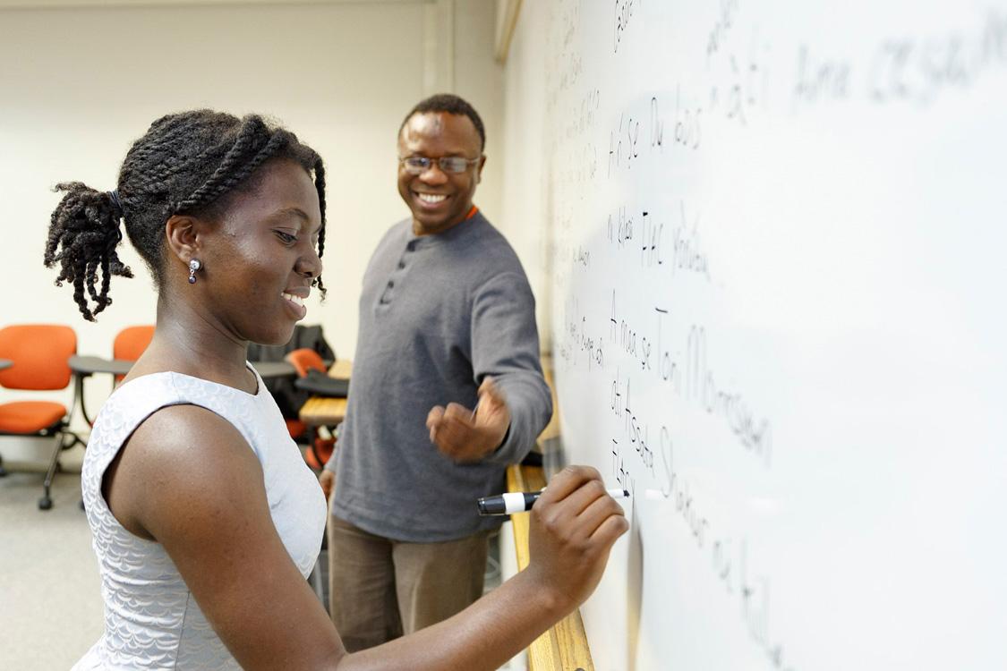 Guiding a student in writing in Yoruba
