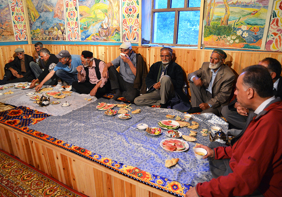 Research team meal with villagers in Savnob
