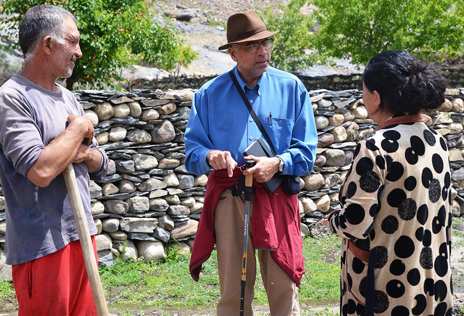 Karim Kassam and villagers in Savnob