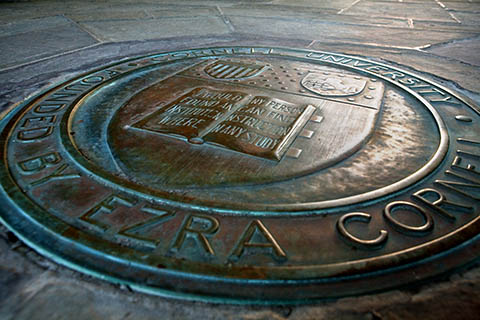 The bronze university seal embedded in the floor of Myron Taylor Hall.