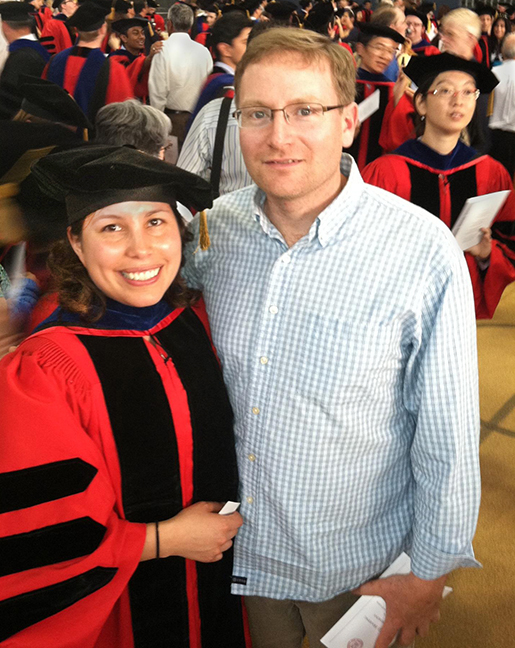 Ospina at her PhD commencement ceremony, with her husband Brian Stratton