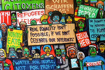Colorful paining with cartoon people holding signs about equality