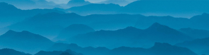 Abstract image of layers of blue mountains